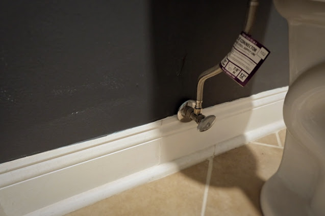 removing tag from toilet water line