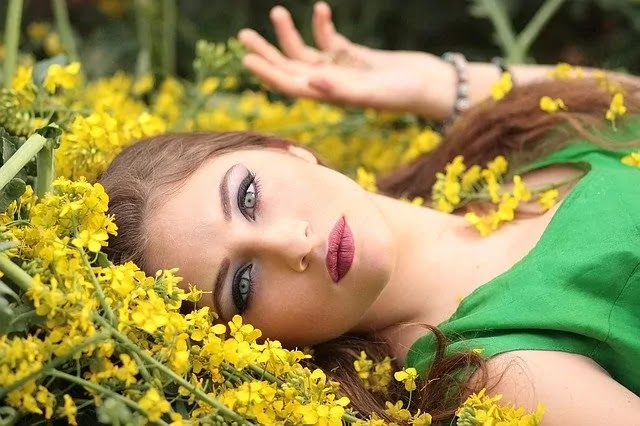 girl sleep on the yellow flower