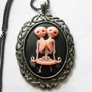 Conjoined twin necklace cameo