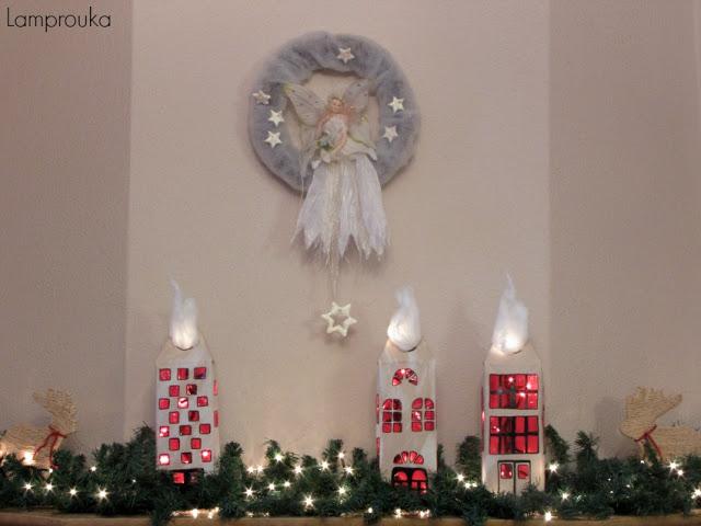 Χριστουγεννιάτικη διακόσμηση τζακιού με σπιτάκια από κουτιά γάλακτος.