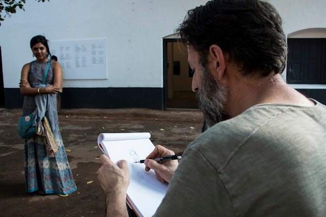 Artist Daniele Galliano drawing the sketches of  visitors at Aspinwall House,Fortkochi