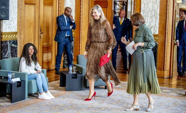Queen Maxima wore a debora leopard-print midi dress from Natan. Gianvito Rossi red suede pumps and red suede clutch