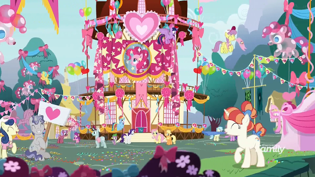 Ponyville decorated in a Pinkie Pie theme including Pinkie balloons, banners, and t-shirts.