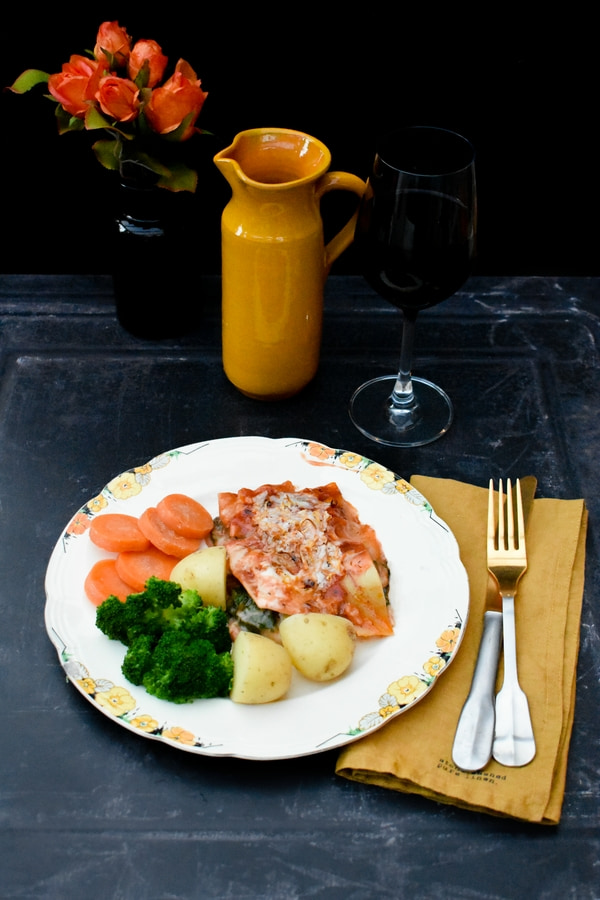 Easy Spinach & Corn Veggie Lasagne served on a cream plate with baby potatoes, slices of carrot and florets of broccoli)