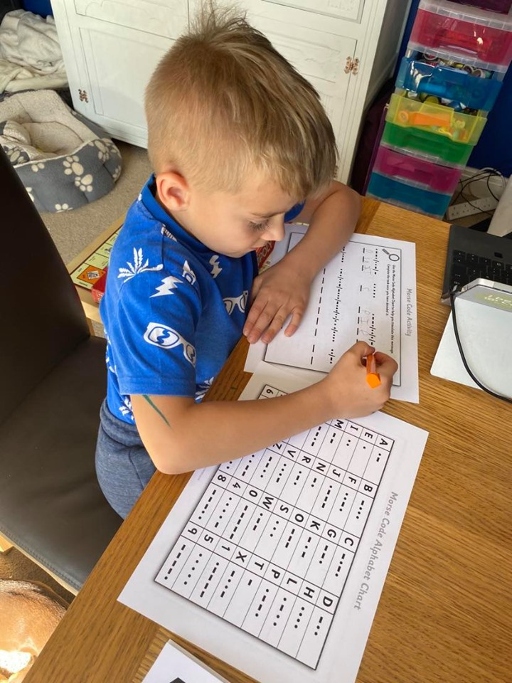 child learning morse code