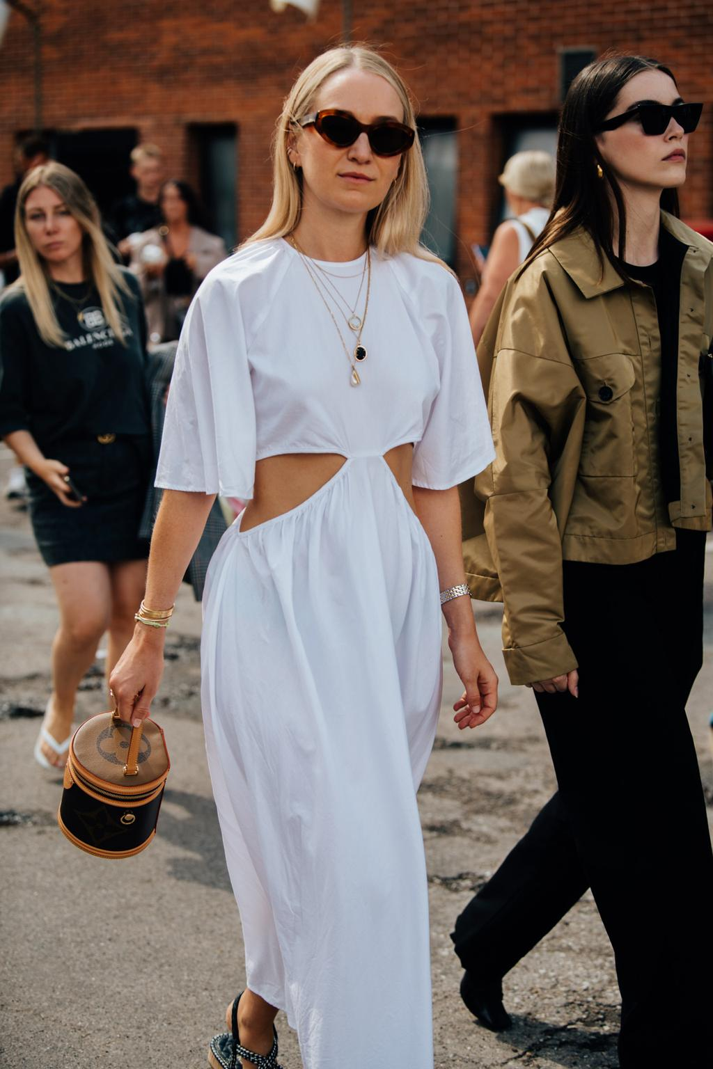 25 of the Coolest Cutout Dresses for Spring and Summer — White Side Cut Out Dress Trend 2021