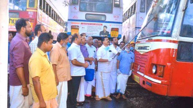 Transport workers disinfect the Neyyattinkara bus stand and KSRTC buses to prevent coronavirus spread.,www.thekeralatimes.com