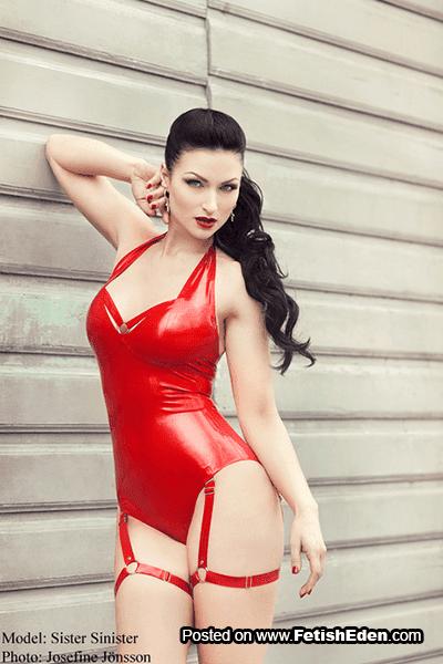 Blue-eyed Sister Sinister brunette in red latex body
