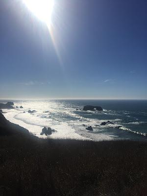 sunshine over rugged coast