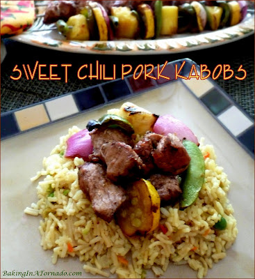 Sweet Chili Pork Kabobs: pork tenderloin, vegetables and pineapple chunks marinated, skewered and grilled. | Recipe developed by www.BakingInATornado.com | #recipe #dinner