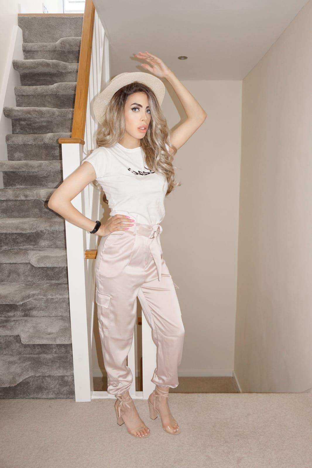 The Femme Luxe White 'Basic' Short Sleeve Slogan T-Shirt in model Ashton.