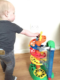 Jacob playing with a Thomas spiral station toy