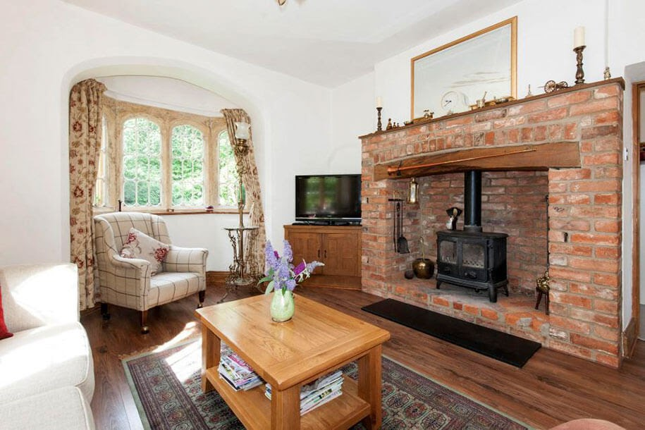 04-Living-Room-and-Fireplace-Molly-s-Lodge-the-Smallest-Castle-in-England-www-designstack-co