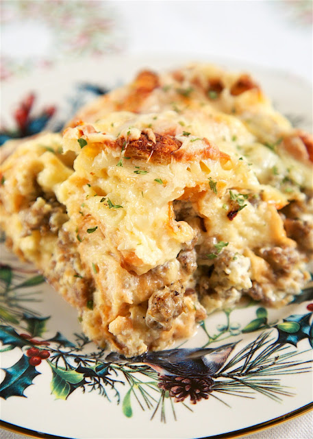 Overnight Cheesy Sausage and Croissant Casserole - buttery croissants, sausage, eggs, heavy cream and gruyere cheese - make and refrigerate overnight. SO delicious!! Great casserole recipe for Christmas morning!