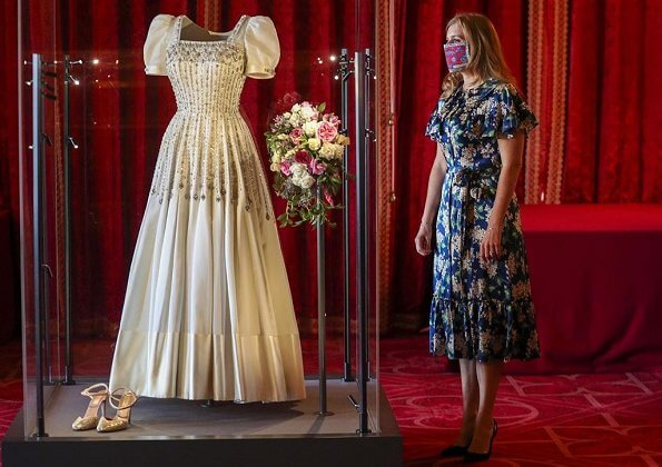 Princess Beatrice wore The Vampire's Wife's floral print silk midi dress, Princess Beatrice's wedding shoes, made by Valentino. wedding dress