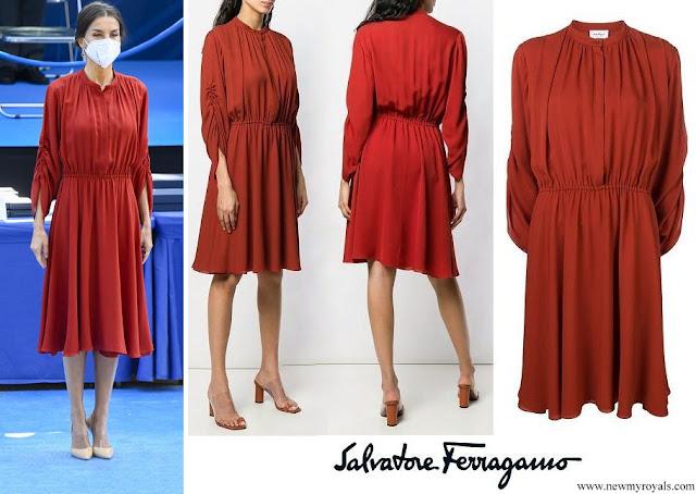 Queen Letizia wore a long sleeve flared midi red dress by Salvatore Ferragamo