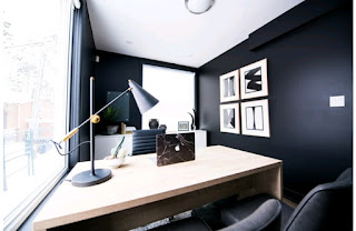 An office with a white and black interior