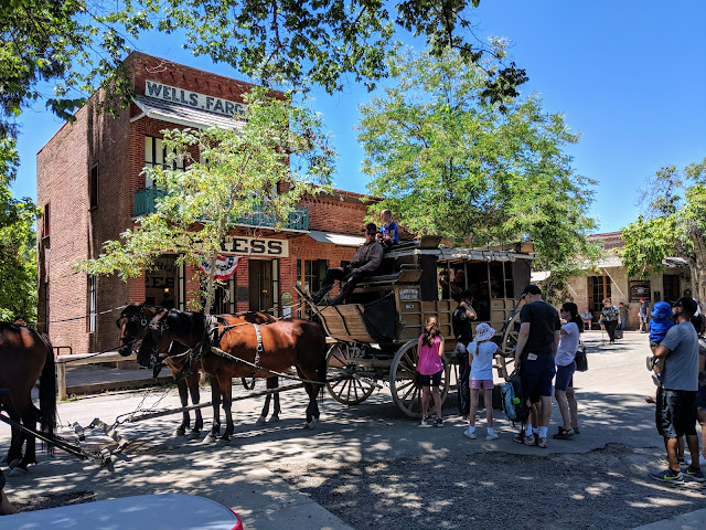 Tourists line up to ride the stagecoach