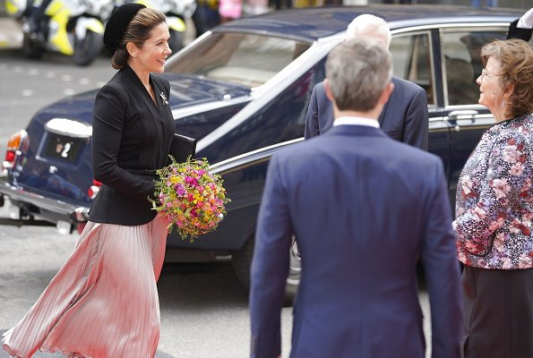 Queen Margrethe, Princess Benedikte. Crown Princess Mary wore a rose gold metallic pleated midi skirt from Asos Design, and a blazer by Max Mara