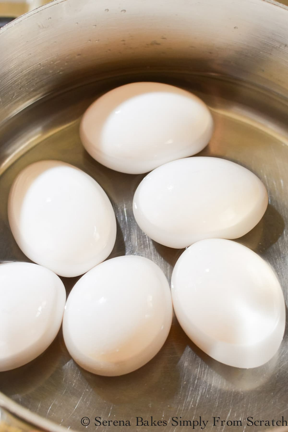 6 whole Eggs in a stainless steel pot filled half way up the eggs with water.