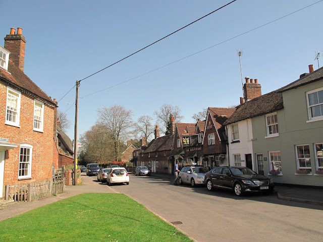 The utterly pleasant main street of Chawton, with Jane Austen's House Museum on one side and Cassandra's cup on the other.