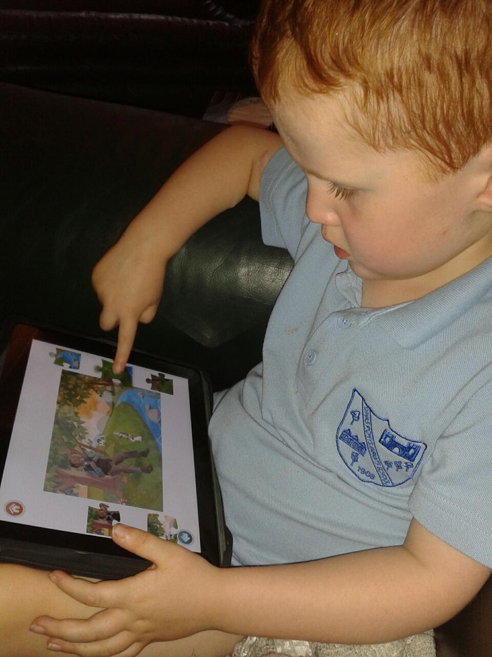 Ieuan playing Justin's Jigsongs App on iPad