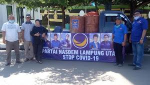 Fraksi partai Nasdem Lampura didampingi DPC. Kota lalukan penyemprotan disinfektan