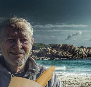 Man holding baguette on island
