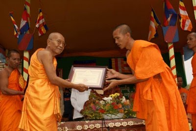 Mai Samoeun is a Director and Head Monk (on the right)