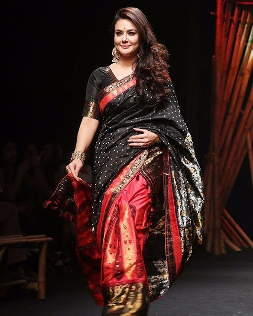 Preity Zinta wearing a black saree