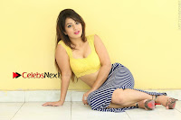 Cute Telugu Actress Shunaya Solanki High Definition Spicy Pos in Yellow Top and Skirt  0300.JPG