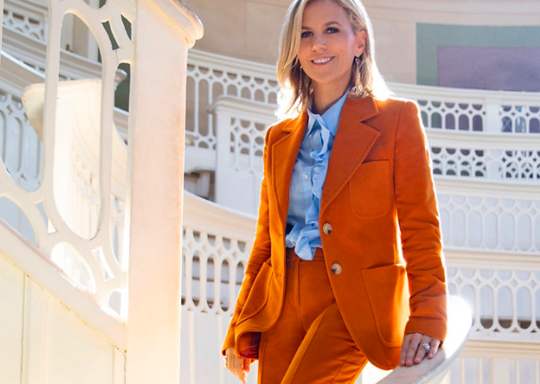 Designer Tory Burch in pant power suit