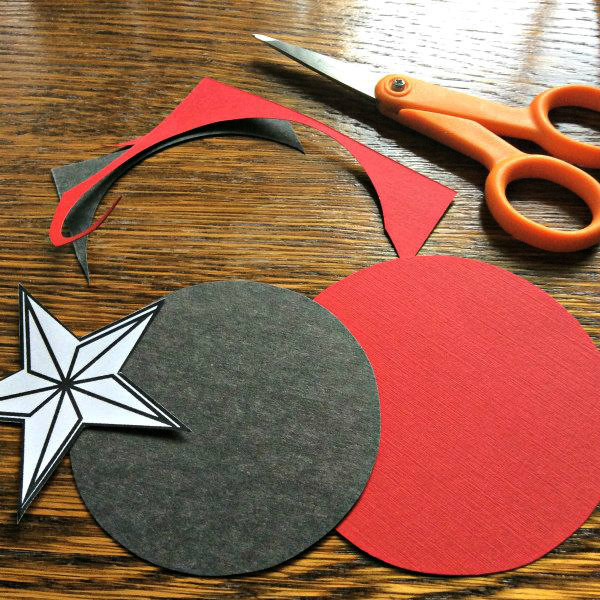handcut circles, paper star pattern, and detail scissors