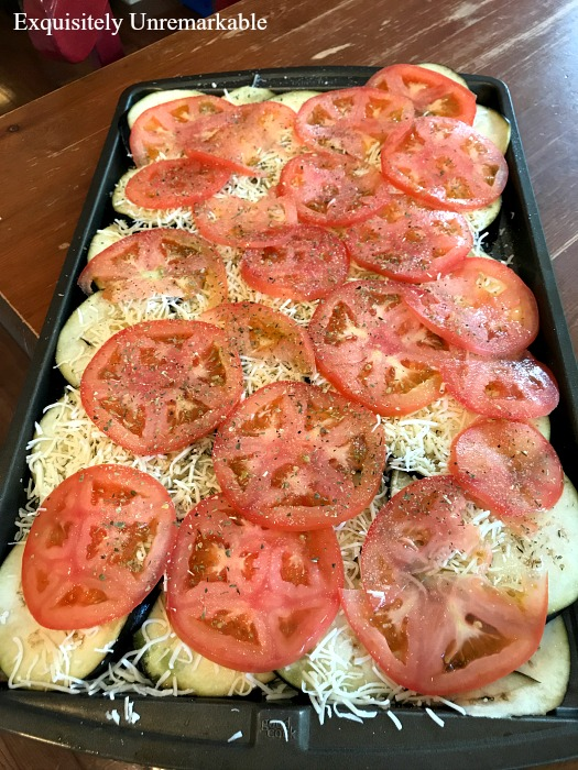 Sliced Eggplant Dish with cheese tomatoes eggplant on a try