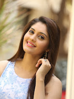 Surabhi latest cute looking photos-cover-photo