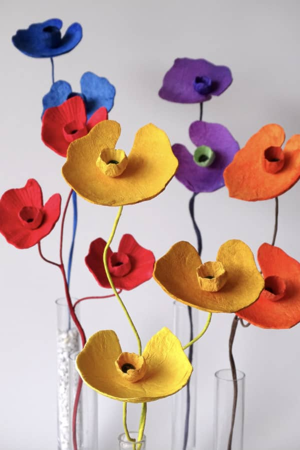 single stem paper flowers in vivid colors