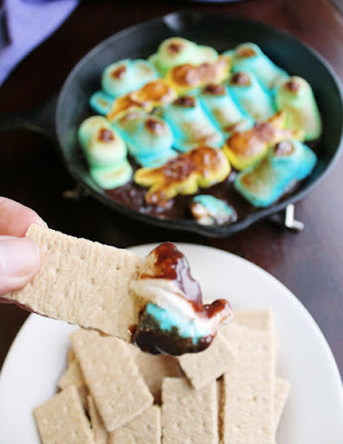 graham cracker with melted peeps and chocolate on the end