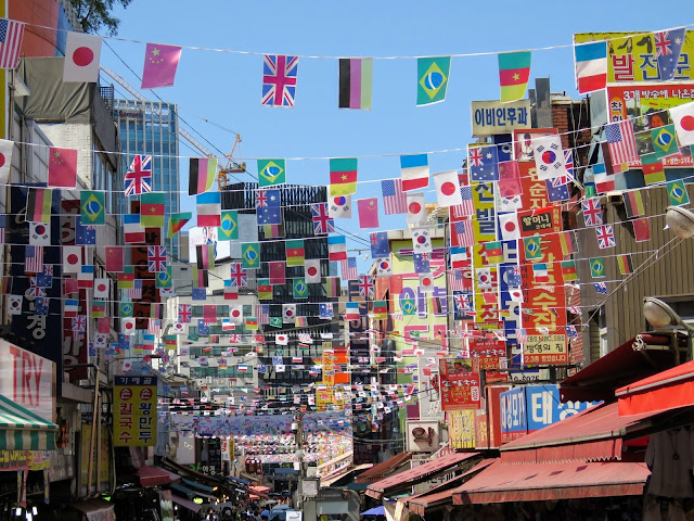 World flags over Namdaenum Market in Seoul South Korea