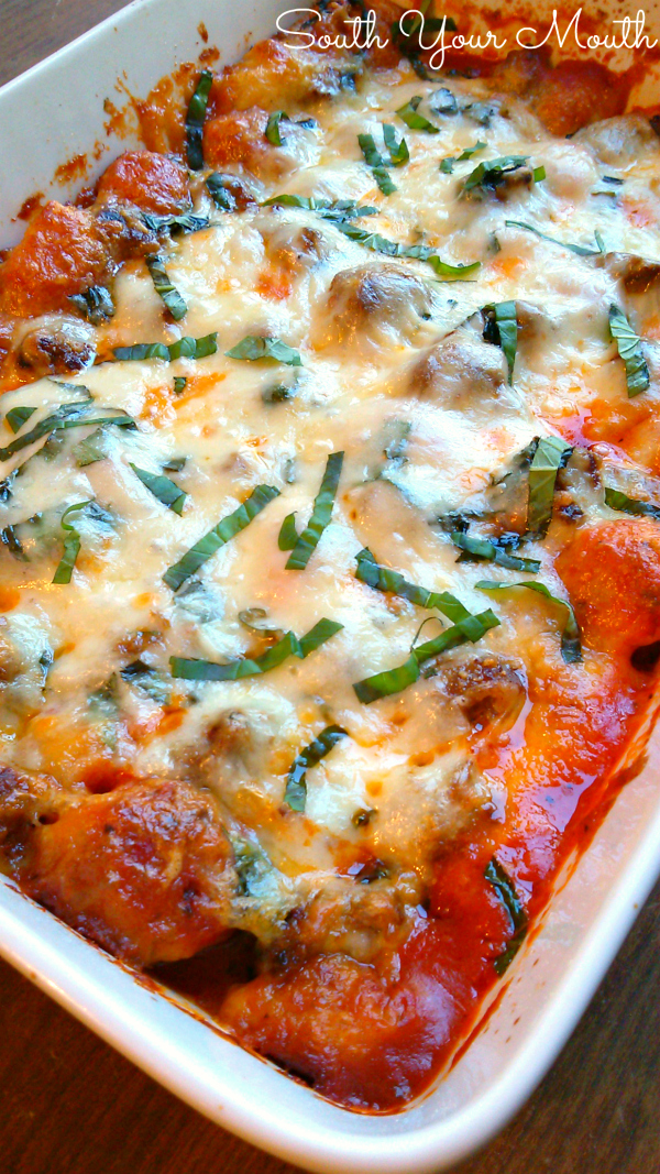 Garlic Knot Casserole with Sausage Meatballs! A quick and easy casserole recipe with garlic knots made from refrigerated biscuit dough, Italian sausage meatballs, marinara and mozzarella cheese that eats a lot like a deep-dish pizza!