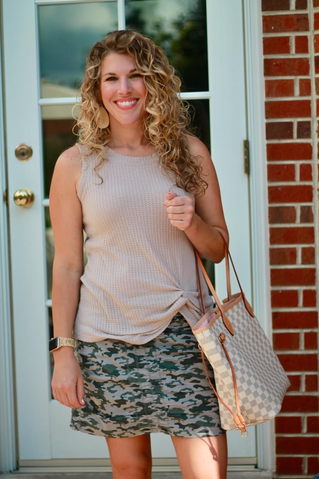 camo skirt, steve madden travel sandals, LV Neverfull, beige twist front top