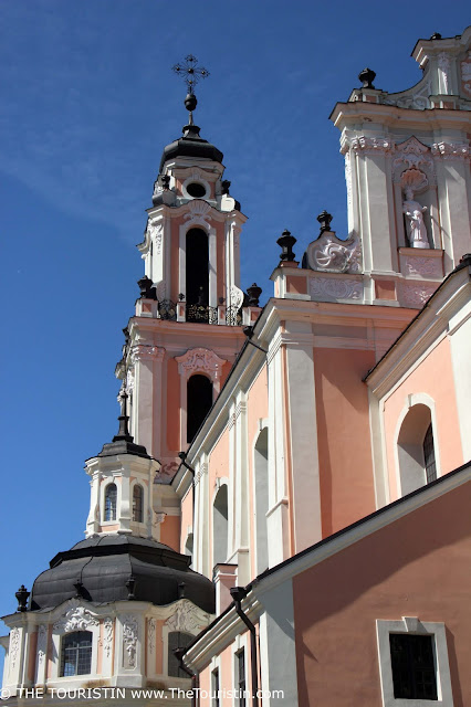 Deatil of the pastel coloured facade of Baroque style Saint Catherine's Church in Vilnius in Lithuania