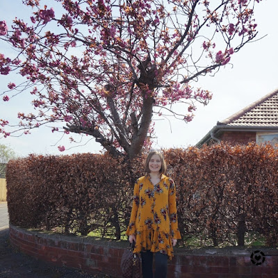 awayfromblue Instagram | cherry blossom tree blogger photo with floral print swing dress leggings