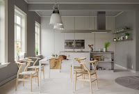 Awesome Scandinavian dining room with white dining table and astounding wooden dining chairs