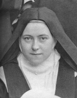 A black and white picture of St Theresa of Child Jesus