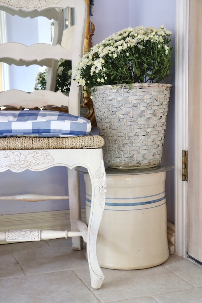 Fall blue and white cottage style small foyer lives large with vintage crock used as a side table