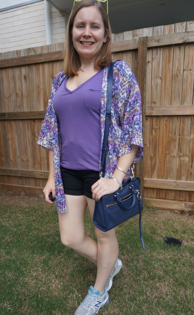 matching purple tee to printed kimono with black denim shorts and navy bag | away from blue