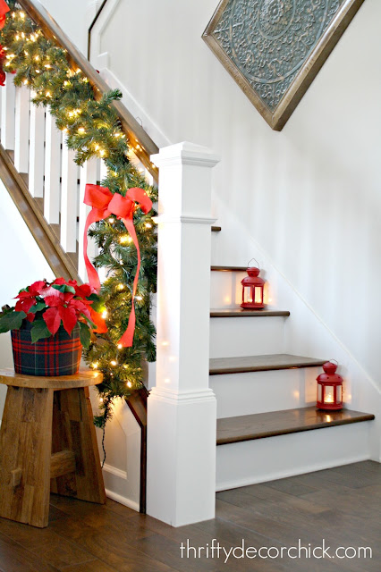 Greenery and DIY bows on stair railing
