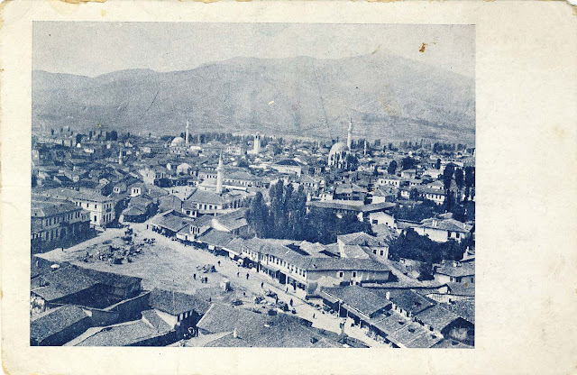"""Panorama of Bitola made from the minaret of Haydar Kadi Mosque in 1915. In the foreground is """"Drven Pazar"""" (Wood Market, later called Sheep Market ) and further is Sungur Chaush Mosque (does not exist today), Isak Mosque, Yeni Mosque and Clock Tower. The postcard was published and printed in: Printing House- Boushinov"""