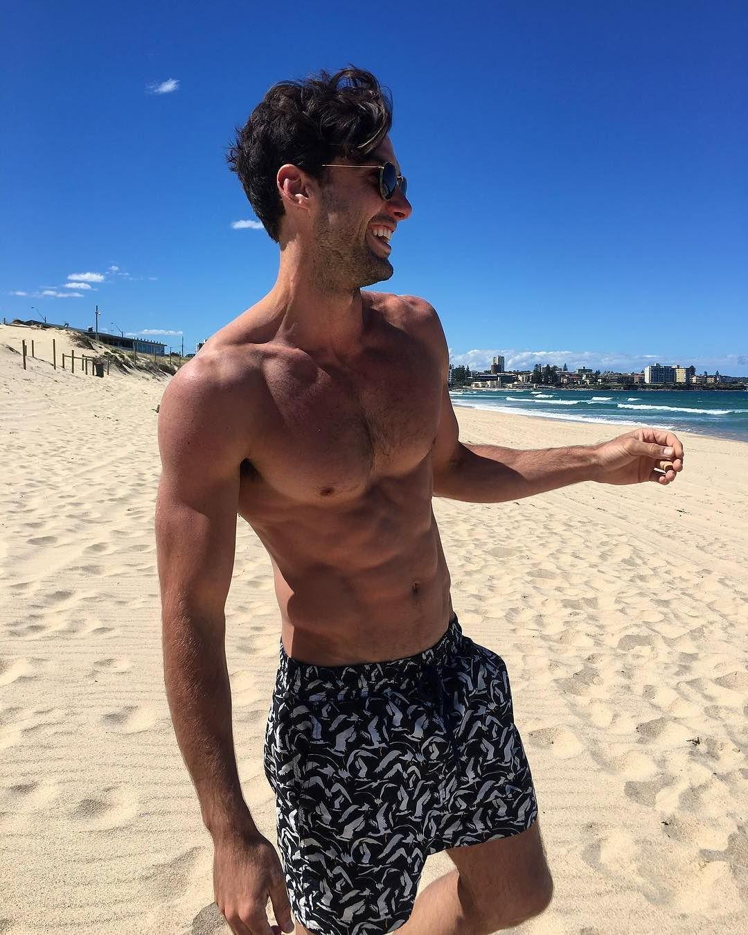 cute-hairy-barechest-gay-bottom-guy-smiling-beach-babe