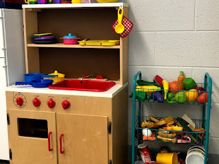 A play kitchen is a must have for preschool speech therapy